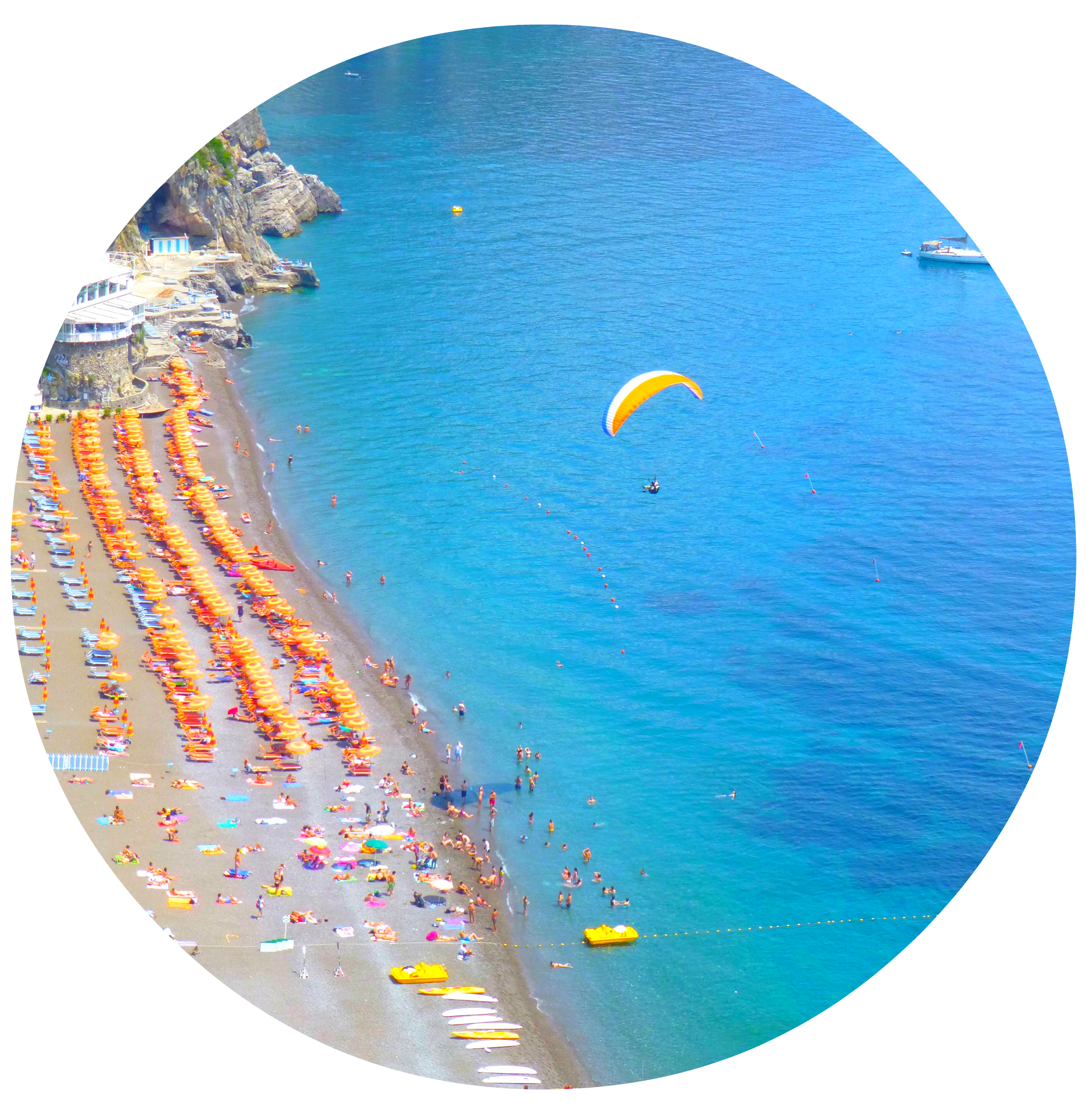 Someone paragliding over Positano beach, looking from Caffe Positano